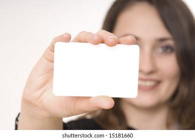 Beautiful woman holding empty gray board