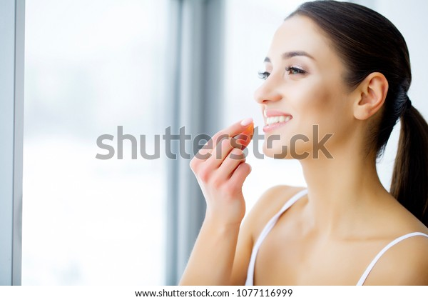 Beautiful Woman Holding Fish Oil Pill In Hand. Healthy Nutrition