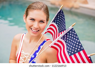 A Beautiful woman holding flags in a pool