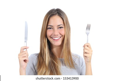 Beautiful woman holding a fork and a table knife isolated on a white background