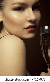 Beautiful woman holding glass of champagne.