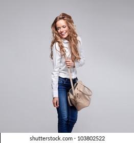 Beautiful woman holding a handbag