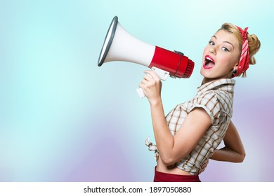 Beautiful woman holding megaphone and screams