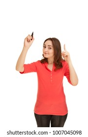 Beautiful woman holding a pen and pointing up finger and looking to the camera isolated on white. Concept of good idea.