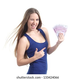 Beautiful woman holding and pointing a lot of five hundred euro banknotes isolated on a white background