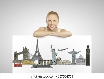 beautiful woman holding poster with traveling concept