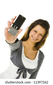 Beautiful woman holding in reach hand mobile phone. Looking at camera and smiling. Front view. White background.