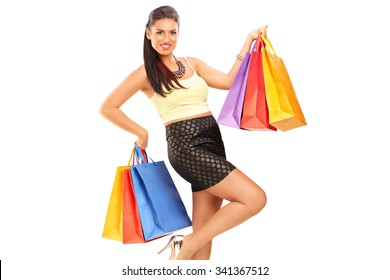 Beautiful woman holding shopping bags and smiling isolated on white background
