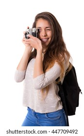 Beautiful woman holding a vintage camera, isolated over white background