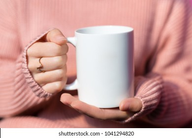 Beautiful woman holding a warm mug