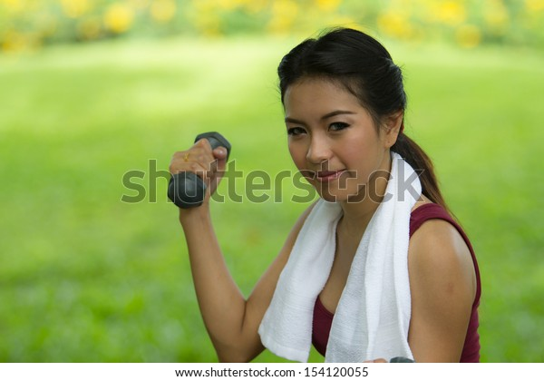 Beautiful woman holding weights in her hands
