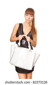 beautiful woman holding a white bag