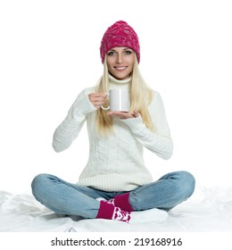 Beautiful woman holding white cup
