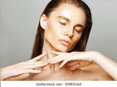 Beautiful woman with honey on her face. Healthy perfect skin. Honey treatment.