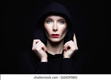 beautiful woman in hood. red lips woman in black hoodie
