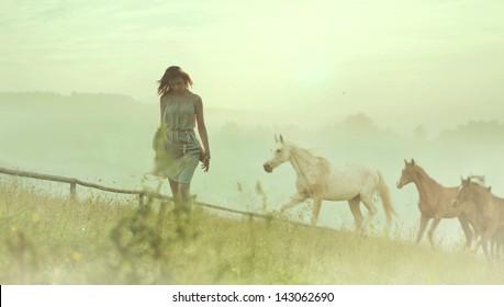 Beautiful woman and horses