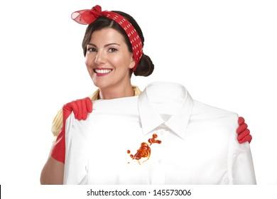 beautiful woman housewife showing a dirty shirt  on white