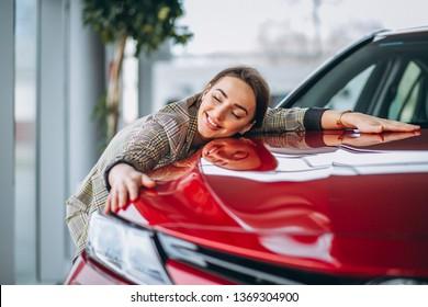 Beautiful woman hugging a car