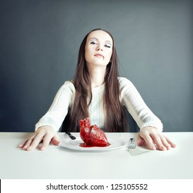 beautiful woman and human heart on the plate (concept)