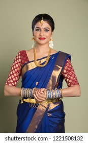 beautiful woman indian in saree, indoor lighting