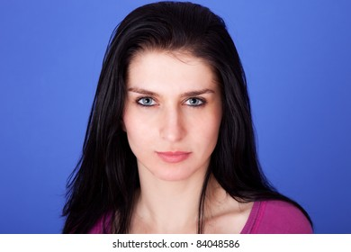 beautiful woman isolated on blue background, studio shot.