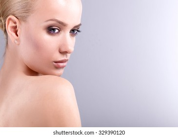 Beautiful woman , isolated on gray background