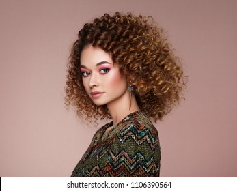 Beautiful  woman in a jacket. Perfect makeup. Beauty fashion. Elegant afro curly hairstyle.