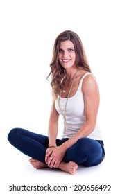 Beautiful woman in jeans and sleeveless shirt, studio portrait. Isolated on white.