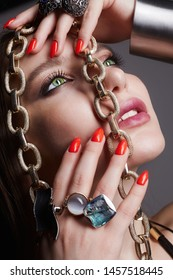beautiful woman with jewellery. fashion girl with beauty make-up and necklace, rings and bracelet