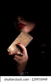 Beautiful woman with jewelry bijouterie in dark. Fashion portrait