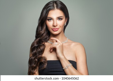 Beautiful Woman with Jewelry Diamond Necklace, Bracelet and Earrings. Perfect Female Face. Woman with Hollywood Wave Hairstyle