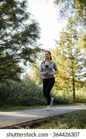 Beautiful woman jogging in  a park