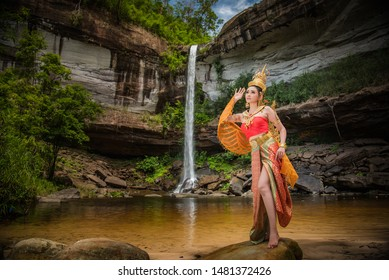 Beautiful woman in a Kinnari dress, Kinnara is an animal in the Himmapan forest.The upper body is human.The lower part is a bird with wings to fly.Lives in the Himapan forest.