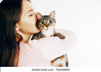 beautiful woman kisses and hugs cat