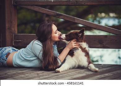 beautiful woman kissing her dog. funny image