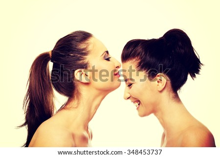 Kissing a woman on the forehead