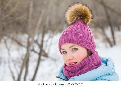 Beautiful woman in a knitted hat for a winter walk