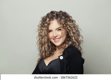 Beautiful woman laughing on white background
