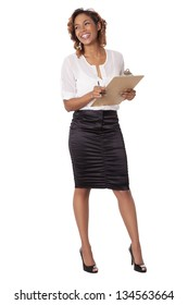 Beautiful woman laughs while holding a clipboard and looks to the side, isolated on white background.