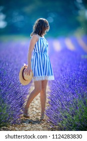 beautiful woman in the lavender fields with high heels