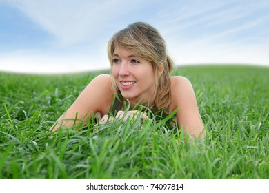 Beautiful woman laying down green field