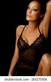 Beautiful woman laying down on black.