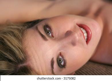 beautiful woman laying down upclose