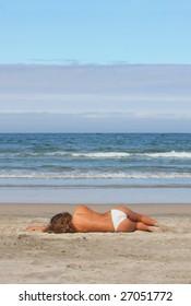 beautiful woman lays on beach