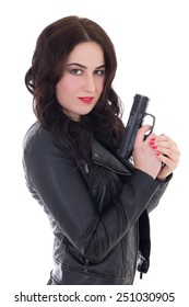 beautiful woman in leather jacket with gun isolated on white background