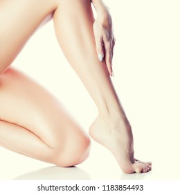 Beautiful woman leg and knee with smooth clean perfect skin. Body and health care concept