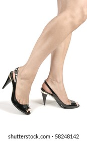 Beautiful woman legs and black heel shoes over white