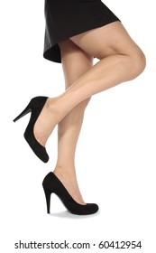 Beautiful woman  legs  with black heels over white