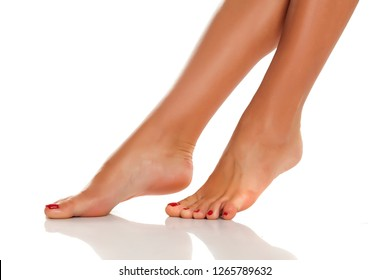 Beautiful woman legs and feet on white background