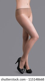 Beautiful woman legs isolated on gray background